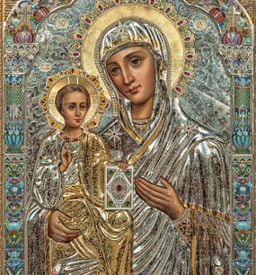 у иконы Божией Матери «Троеручица»
